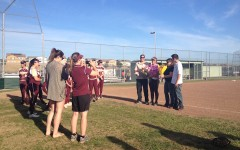 Varsity softball celebrates their only senior at Senior Night
