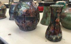 Ceramics students 'raku fire' clay pottery
