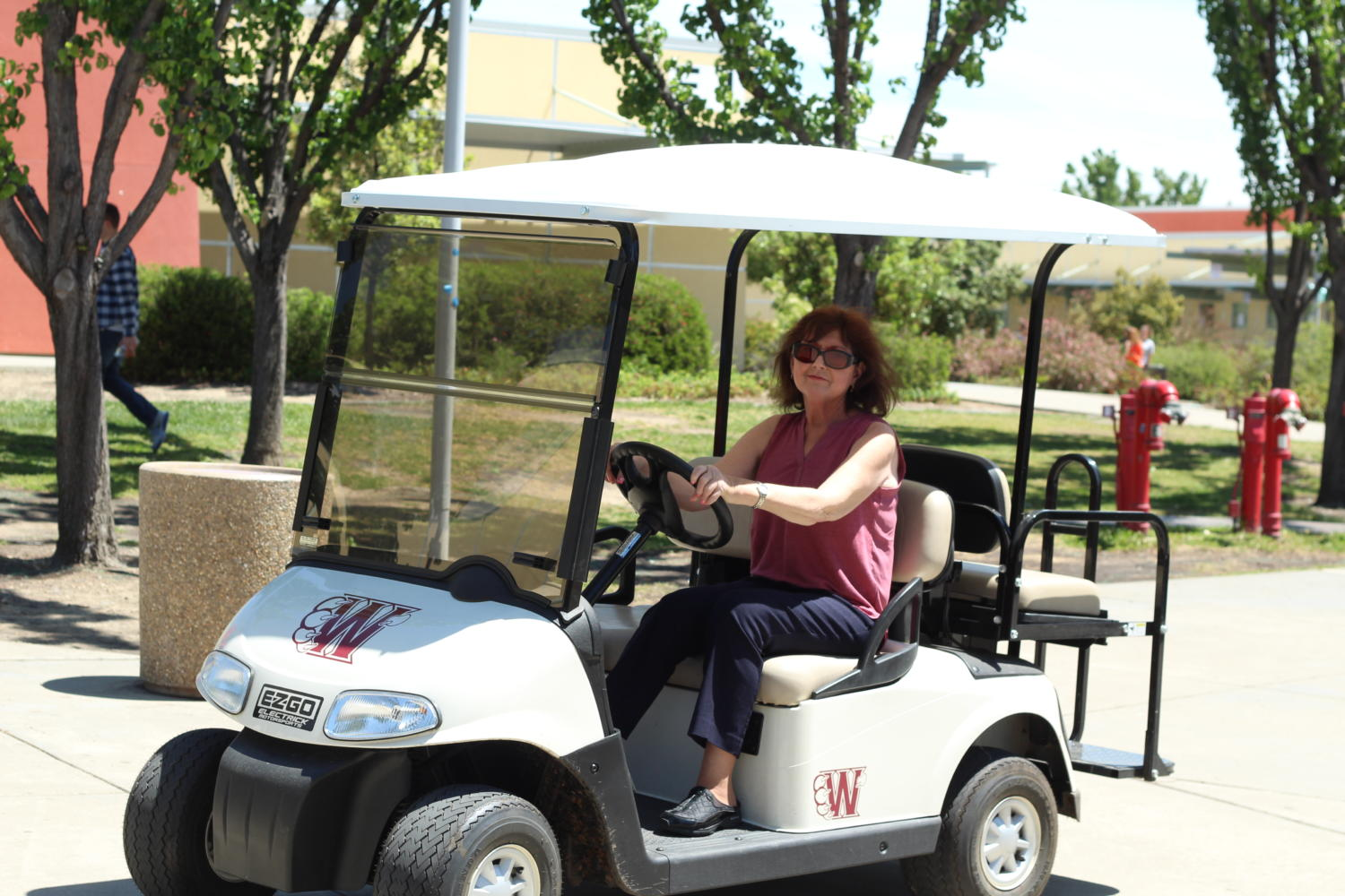 Mrs.+Sherry+Mauser+drives+her+golf+cart+around+campus+at+lunch.+Photo+by+Emma+Kachmar