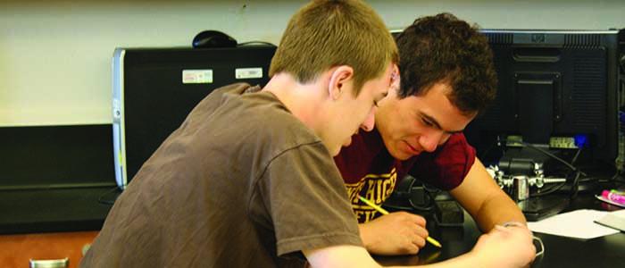 Evan Ja and Ryan Sayle discussing their work in AP Chemistry.