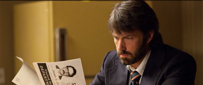 Agent Tony Mendez (Ben Affleck) creates the false identities for the six embassy workers stranded in Iran. Photo from http://argothemovie.warnerbros.com used with permission under fair use.