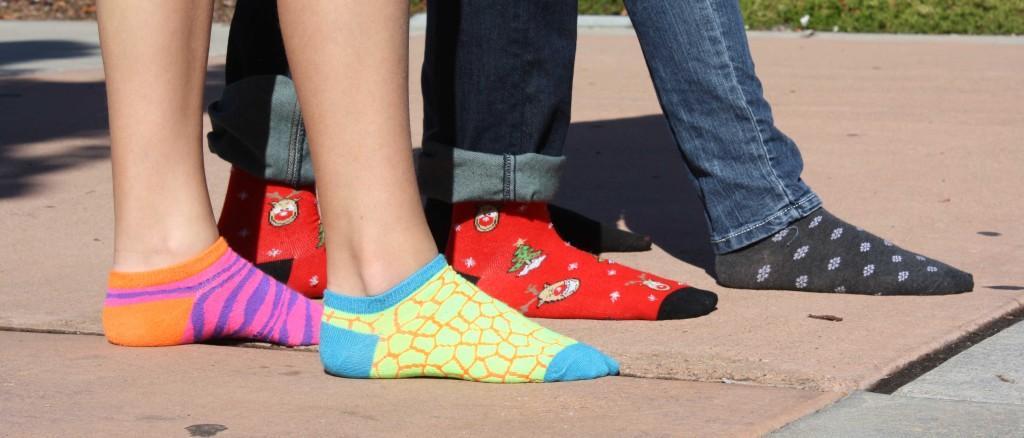 Cool Socks Club members show off socks on Fridays
