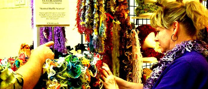 A woman at the craft fair looks through ruffle scarves before making a purchase on Oct. 20. Photo by EMMA RICHIE