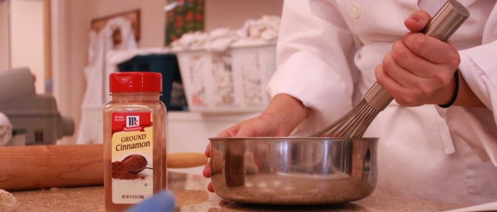 Mariana Avila prepares a dish in the culinary kitchenon Oct. 22. Photo by ARIANA LORDGE