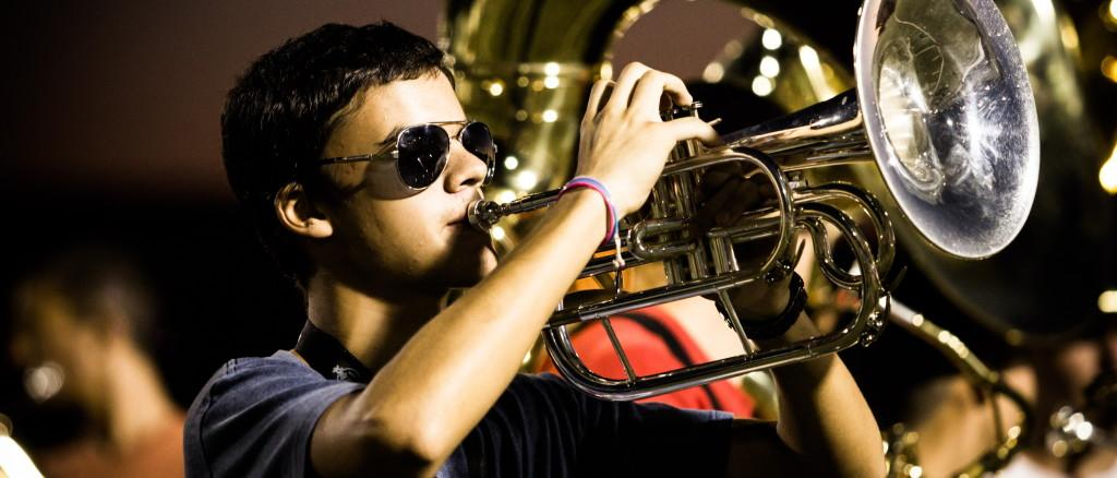 Senior Donovan Lawrence practices playing the trumpet for an upcoming performance. Photo by BRANDON NGUYEN.