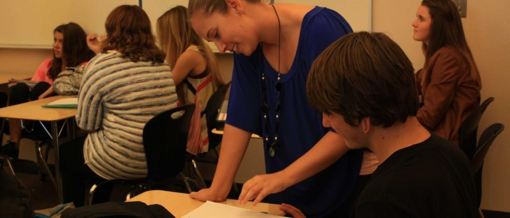 Ms. Nicole Ferguson helps Branden Del Pape with his history homework on Nov. 7. Photo by ASHLEY RAYNES