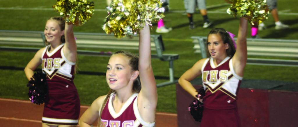 JV cheer team cheers at football game. Photo by ASHLYN ELLIS
