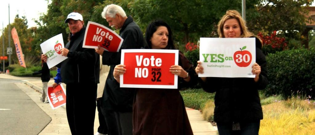 Mr. Jim Trimble, Mr. Kevin Brown and other district members attend the Yes on 30 rally on Oct. 22. Photo by EMMA RICHIE