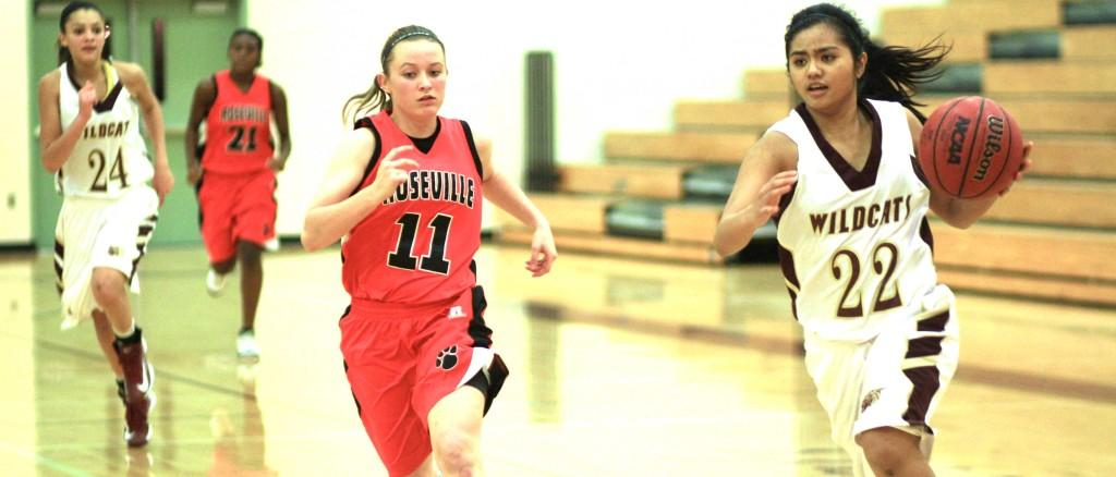 #22 Janelle Sanchez dribbles to the basket to make a layup in a game against Roseville on Dec. 18. Photo by EMMA RICHIE