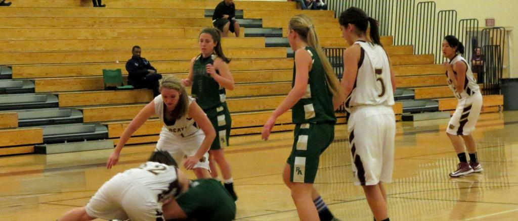 Shelbi Meyer fights with Rio Americano girl for the ball and Molly Miles tries to help. Phot by Ariella Appleby taken on Jan. 17
