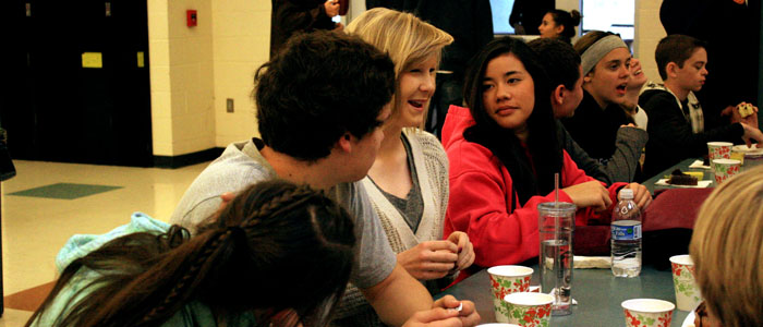 Juniors Sophie Butler and Valeria Imendia talk with friends at the academic breakfast on Jan. 24. Photo by KAVYA PATHAK