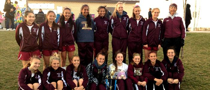 The girls' varsity soccer team poses with their first place trophy at the Cal Spring Classic on Feb. 23. Photo by
