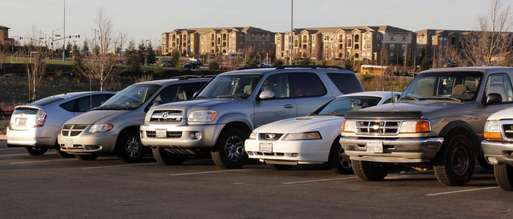 Cars parked in the school parking lot in the morning. Photo by JENICA DODGE