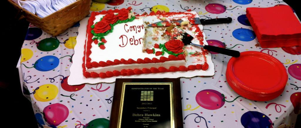 WHS Staff congratulates Mrs. Hawkins for being awarded Administrator of the Year on March 1. Photo by ILAF ESUF