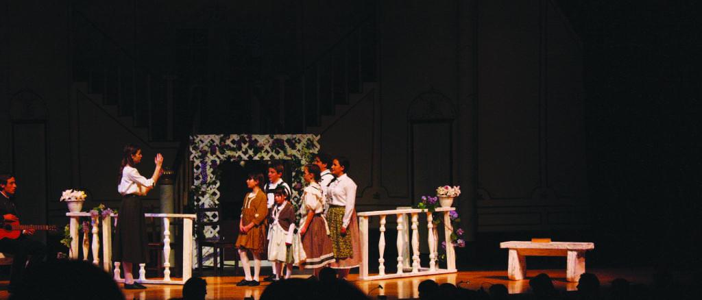 Elsa Schraeder (Hayley Barker) talks to the Von Trapp children in the gold cast of the