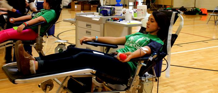 Junior Kori Silva gives blood at the blood drive on March 5. Photo by KAVYA PATHAK.