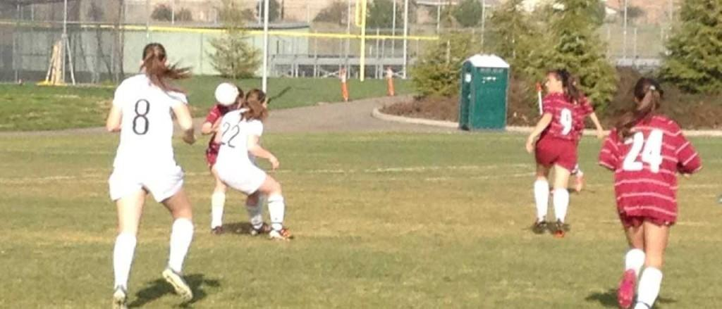 Tara Armstrong facing off against a Granite Bay opponent