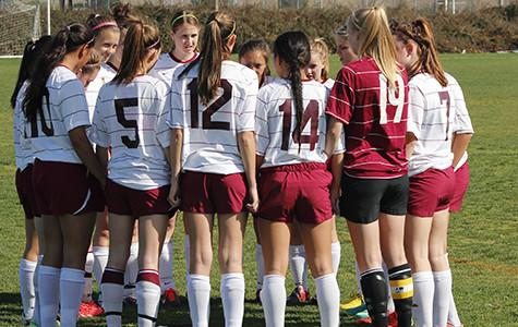 The girls' varsity soccer team prepares for their game against the Roseville Tigers. Photo by JENICA DODGE