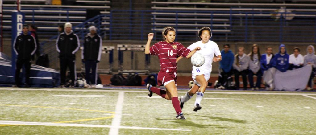 Junior Mikayla English challenges a Rocklin player for the ball. Whitney won the game 1-0 and remains undefeated for the season.