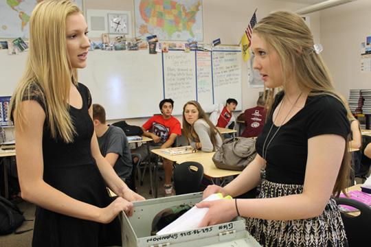 Ellen Mamula and Amanda Carlson add items to the time capsule on May 31. Photo by KAVYA PATHAK.