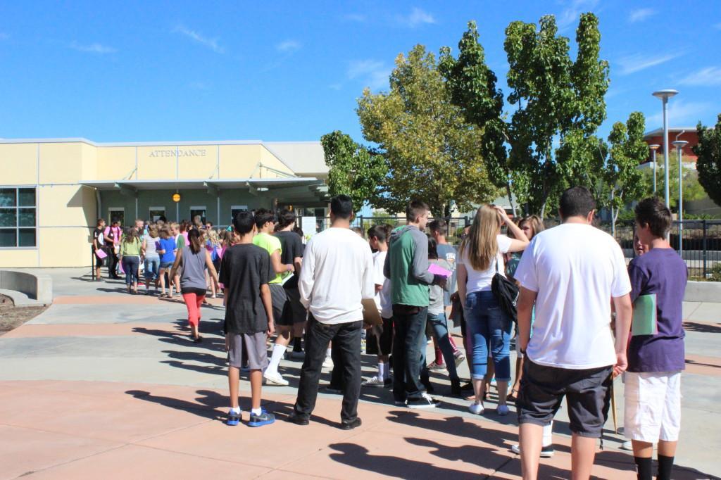 Incoming freshman line up to turn in their emergency forms photo by SAVANNAH HOUDEK
