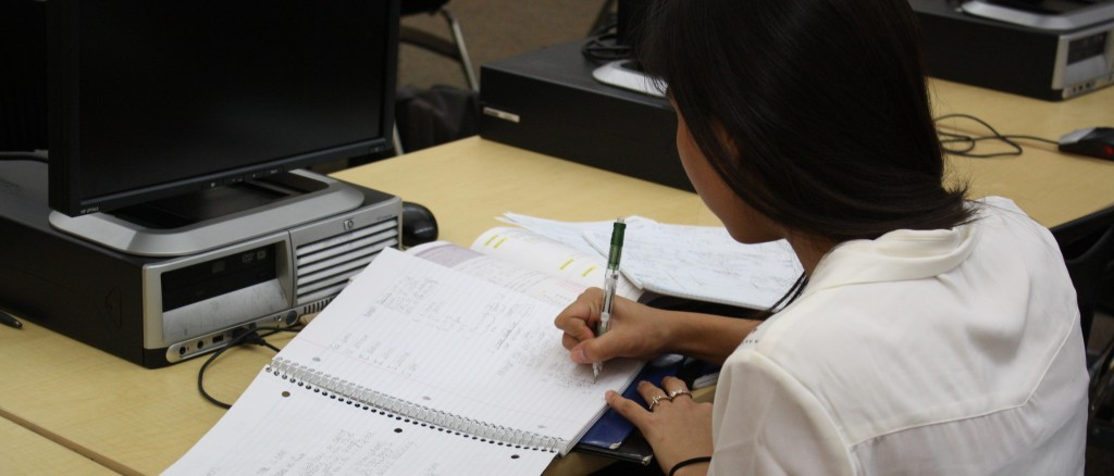 Junior Anessa DeSouza works on her summer homework on Sept. 10. Photo by ABI BROOKS.