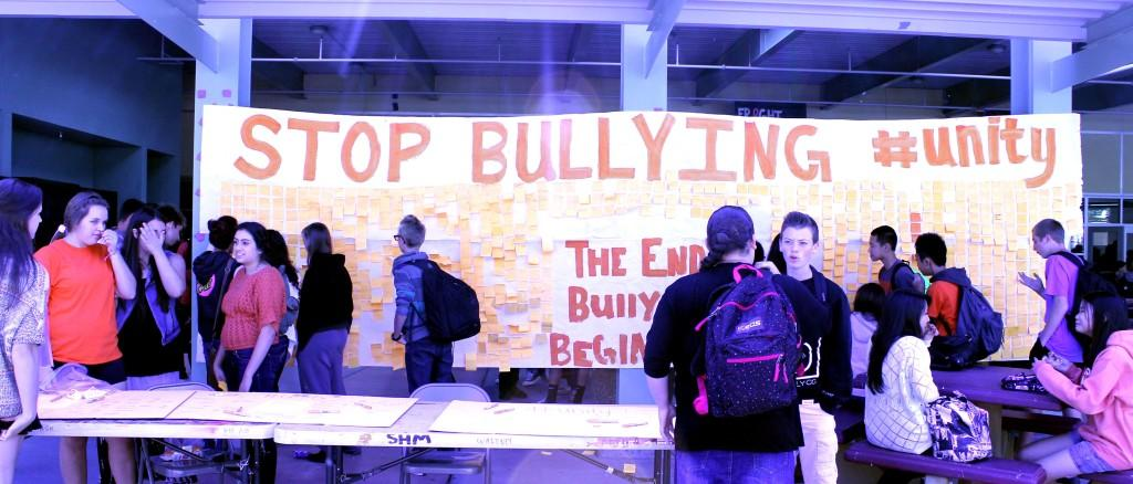 Students+look+at+the+poster+filled+with+others%27+bullying+stories.+Photo+by+Abi+Brooks+on+Oct.+9.
