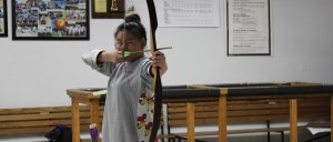 Theresa Kim shoots her first bow on Oct. 15. Photo by CHRISTINA KIM