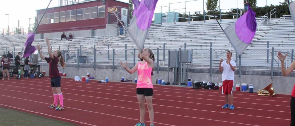 Color guard practices their routine on Sept. 26. Photo by RILEY WYNNE