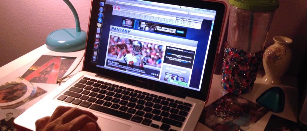 Kaitlyn Townsley scrolls through a fantasy football website