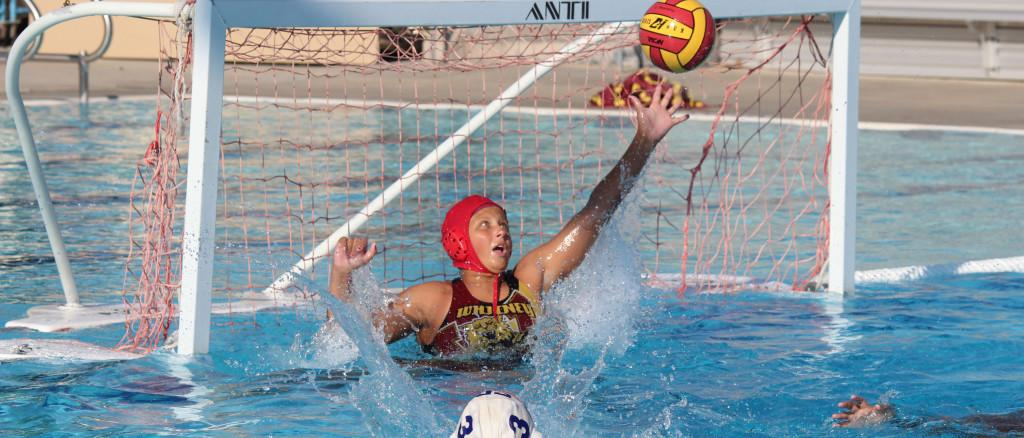 JV+goalie+Kat+Buisson+reaches+out+to+stop+a+goal+from+Rocklin+High+School+on+Sept.+9.+Photo+by+ELLE+HSU+%0A