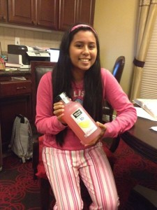 Kristen El Sayegh is dressed in pink and holding a bottle of pink lemonade. Photo by JON EL SAYEGH