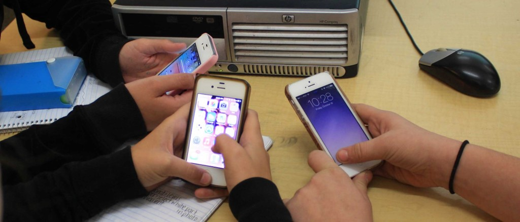 Students using their newly updated IOS 7 Iphones