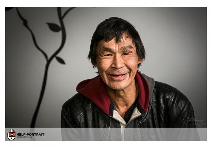John Carver has his portrait done after meeting the photographer at a bus stop. Photo by DARLENE HILDEBRANDT