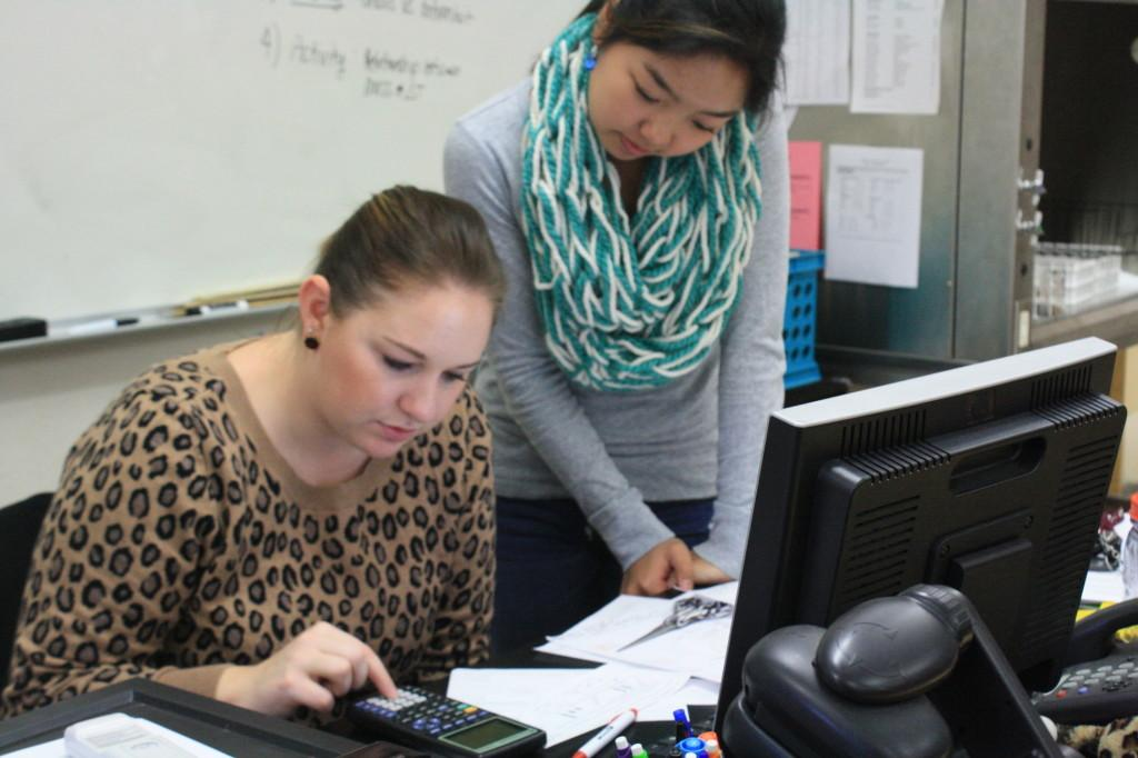 Mrs. Erin Johnson works through a physics problem with junior Makeila Lee during intervention. on Jan. 31. Photo by THERESA KIM