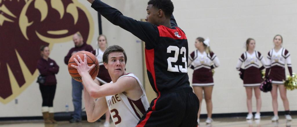 James Kling pushes past a Cordova defender on the Jan. 31 home game. Photo by ARIELLA APPLEBY