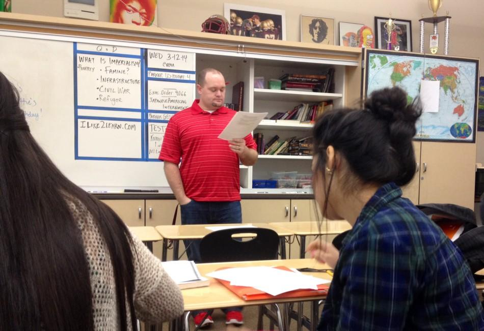 New AP World History teacher Travis Mougette reviews a quiz with his class on Feb. 26