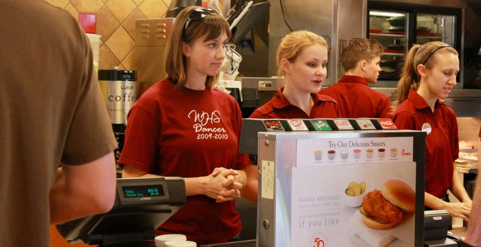 Mrs. Danielle Martling stands beside Chik-fil-a workers, aiding with drinks on April 10