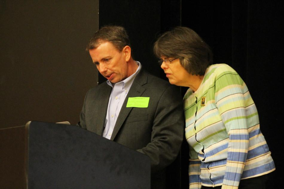 LoMonte and Tinker check their laptop to make sure their presentation will work.  Photo by OLIVIA GRAHL