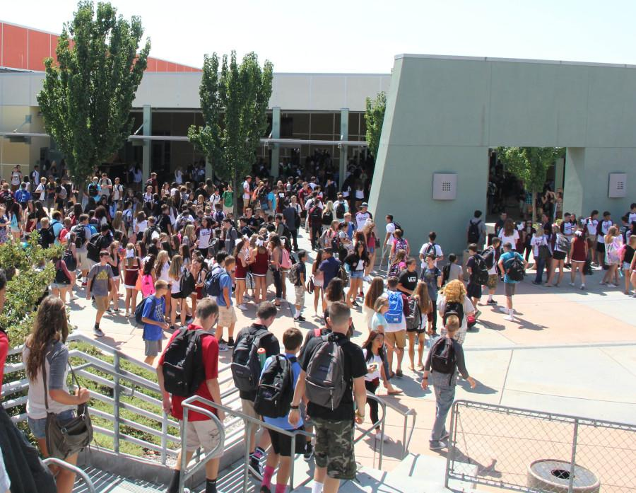 Students compare schedules and catch up during lunch on Aug. 19, the first day of school. Photo by JILL HOLT