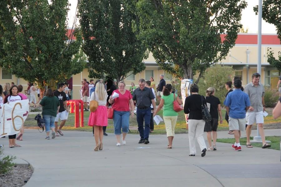 Parents walking from class to class on Back to School Night.