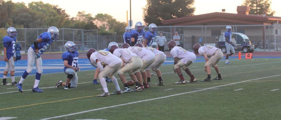 The+Wildcat+offense+lines+up+at+Rocklin%27s+seven+yard+line+to+start+their+play.+Photo+by+Kristen+El+Sayegh.