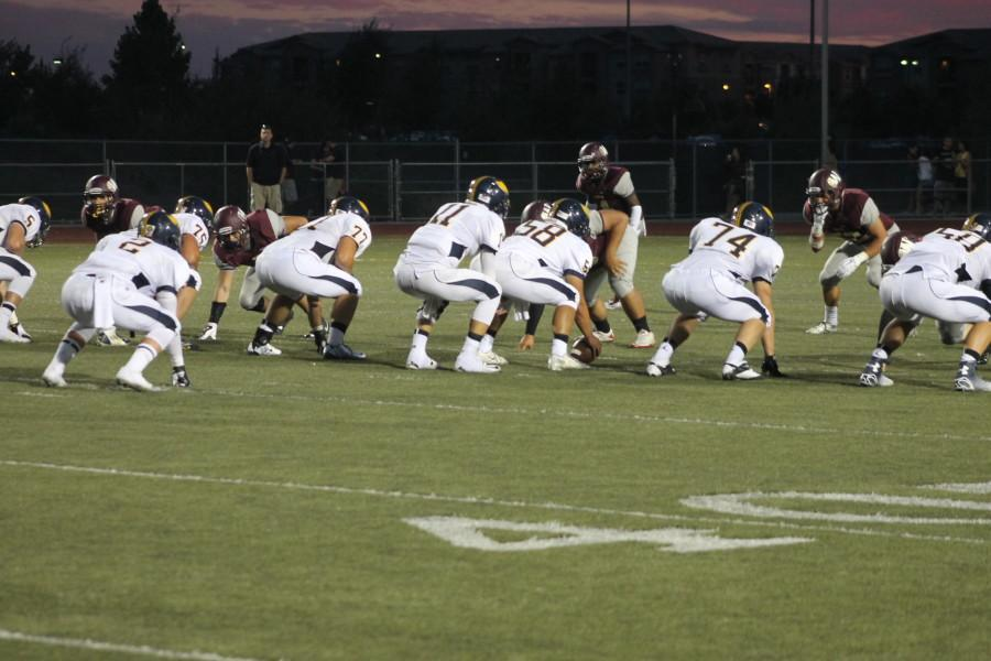 Varsity football sets up for a play in the game against Oak Ridge. Photo by Abi Brooks.