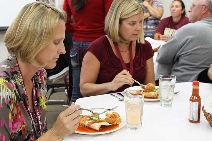 Mrs. Melanie Patterson and Mrs. Jennifer Henry eat enchiladas at the Wildcat Cafe. Photo by Desiree Stone