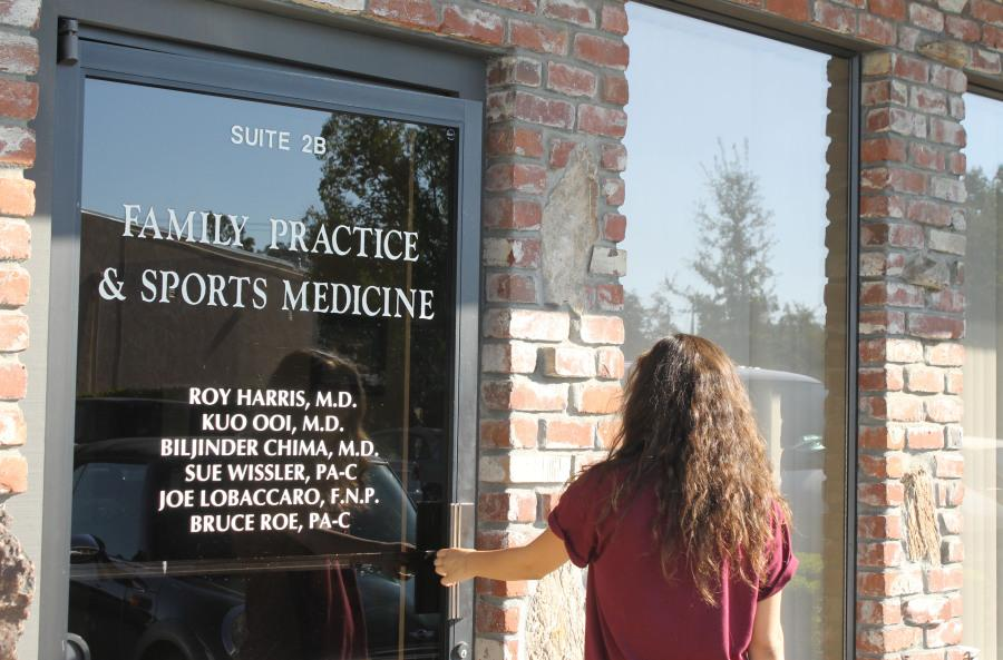 Olivia Grahl walks into Dr. Ku Ooi's office after her third concussion on Oct. 1. Photo by Warren Grahl