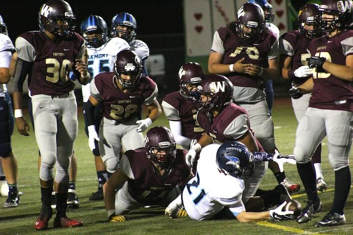 Defense tackles Oakmont No. 21 Trenton Annis in the Oct. 17 Homecoming game. Photo by Jill Holt