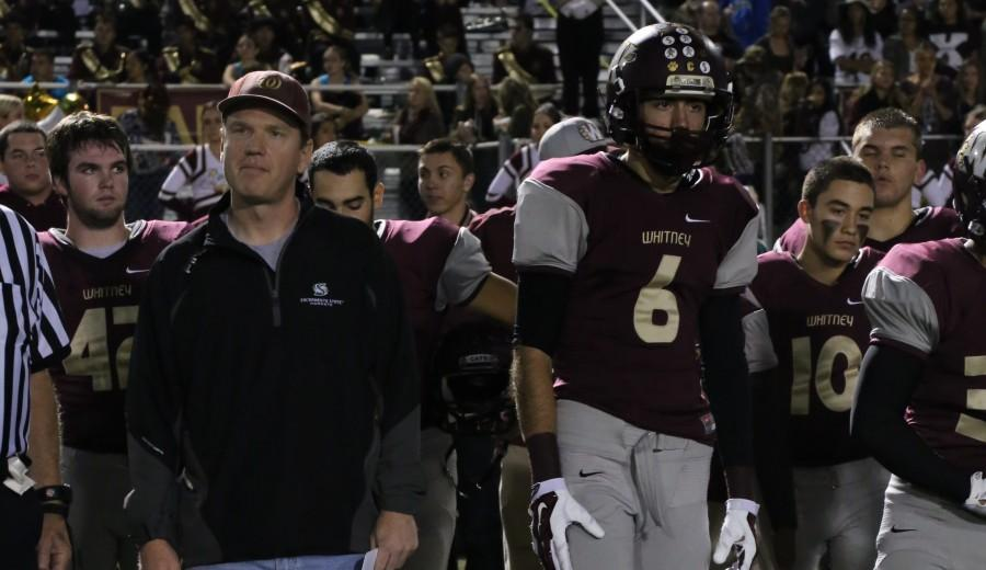 Mr. Patrick Floyd stands on the sideline with the varsity team. Photo by Megan Green.