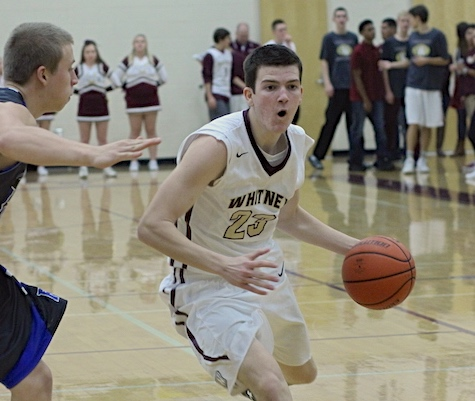 No. 23 Sterling Quinton dribbles toward the basket in the fourth annual Quarry Classic. Photo by Lindsey Immers