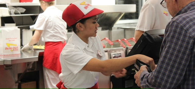 Toby Martinez helps a customer during her shift at In N Out. Photo by Abi Brooks