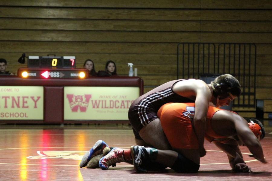 Boys' varsity wrestling match against Cosumnes Oaks on Jan. 27. Photo by Sarah Martinez